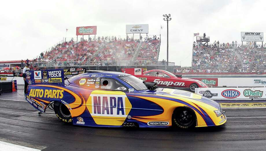 Packing the grandstands to see drivers like Ron Capps compete in the O'Reilly Spring Nationals isn't a problem for the NHRA, but other issues exist in making the circuit more popular. Photo: Bob Levey, Freelance / ©2012 Bob Levey