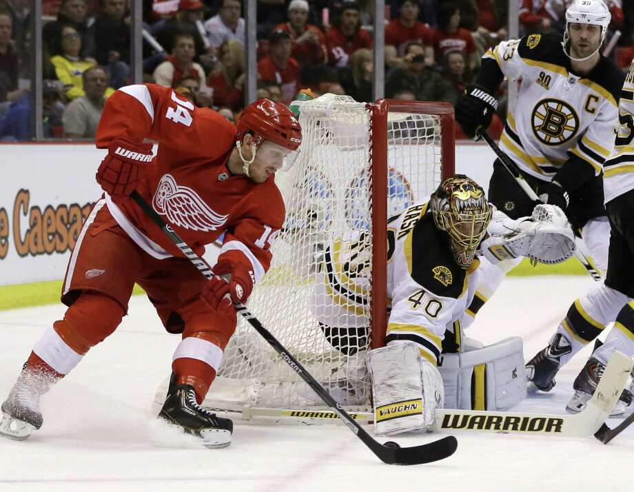 Bruins goalie Tuukka Rask stops a shot by Red Wings center Gustav Nyquist in the second period. Rask made 23 saves. Photo: Carlos Osorio / Associated Press / AP