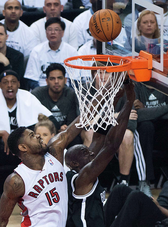 Toronto Raptors forward Amir Johnson (15) defends Brooklyn Nets forward Kevin Garnett during the first half of Game 2 in an NBA basketball first-round playoff series, Tuesday, April 22, 2014, in Toronto. (AP Photo/The Canadian Press, Nathan Denette) ORG XMIT: NSD103 Photo: Nathan Denette / The Canadian Press