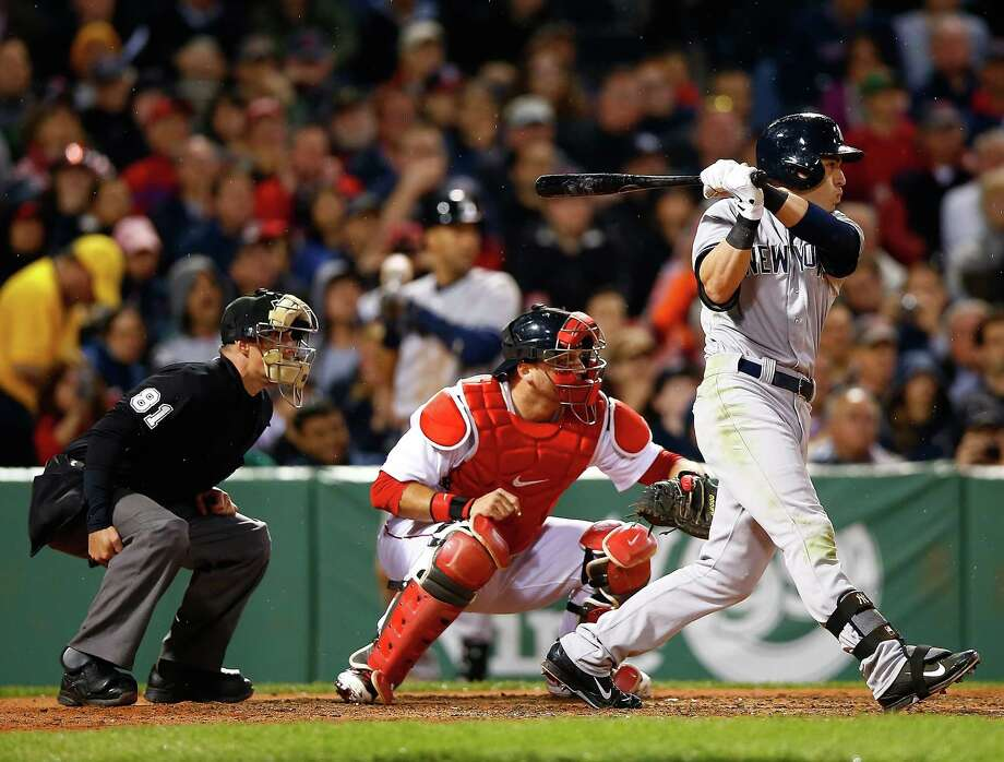 BOSTON, MA - APRIL 22: Jacoby Ellsbury #22 of the New York Yankees hits an RBI double in the fifth inning against the Boston Red Sox during the game at Fenway Park on April 22, 2014 in Boston, Massachusetts.  (Photo by Jared Wickerham/Getty Images) ORG XMIT: 477580353 Photo: Jared Wickerham / 2014 Getty Images