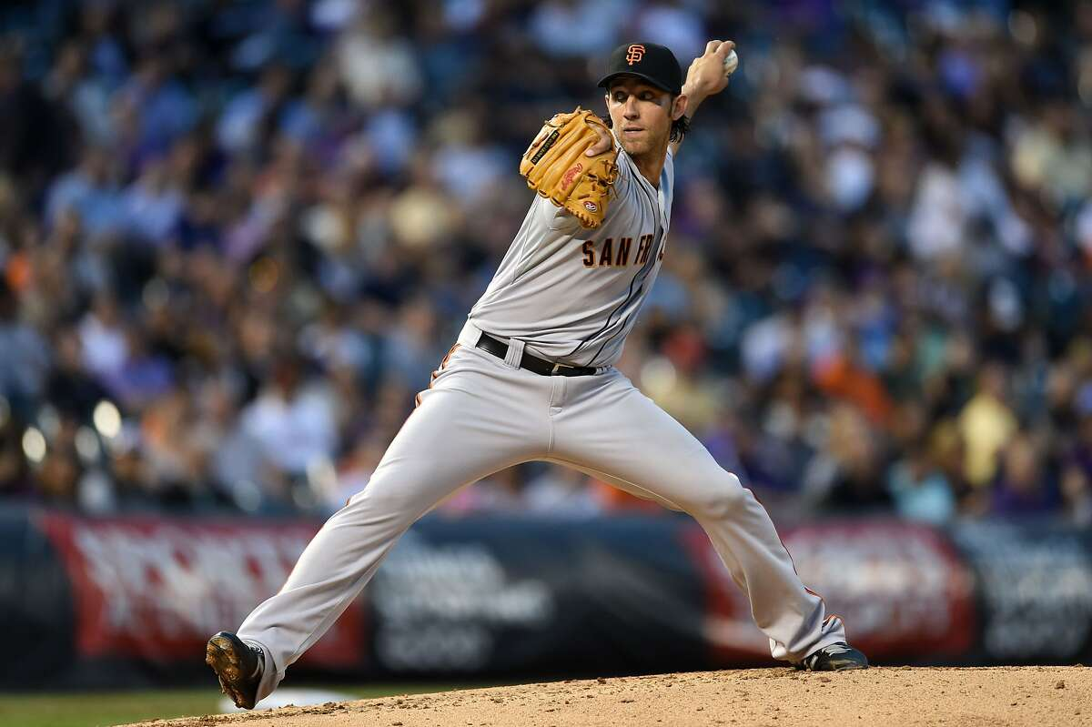 Apr 22, 2014; Denver, CO, USA; San Francisco Giants starting pitcher Madison Bumgarner (40) pitches in the fourth inning against the Colorado Rockies at Coors Field. Mandatory Credit: Ron Chenoy-USA TODAY Sports