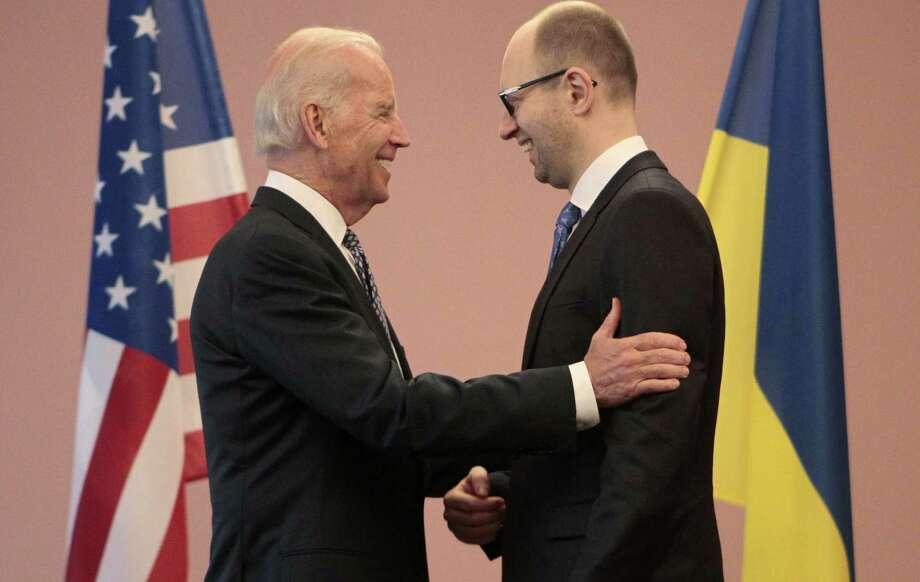 U.S. Vice President Joe Biden (left) talks with Ukrainian Prime Minister Arseniy Yatsenyuk during a meeting in Kiev, Ukraine. Photo: Sergei Chuzavkov / Associated Press / AP