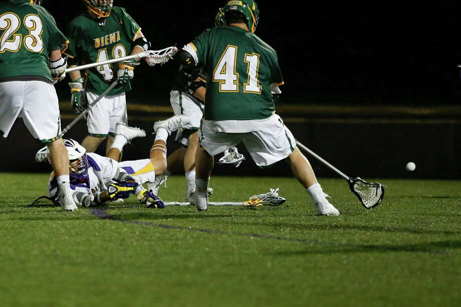 UAlbany's Lyle Thompson makes a diving shot during the men's college lacrosse game against Siena onTuesday, April 22, 2014 in Albany, N.Y. (Dan Little/Special to the Times Union) Photo: Dan Little / Copyright Dan Little