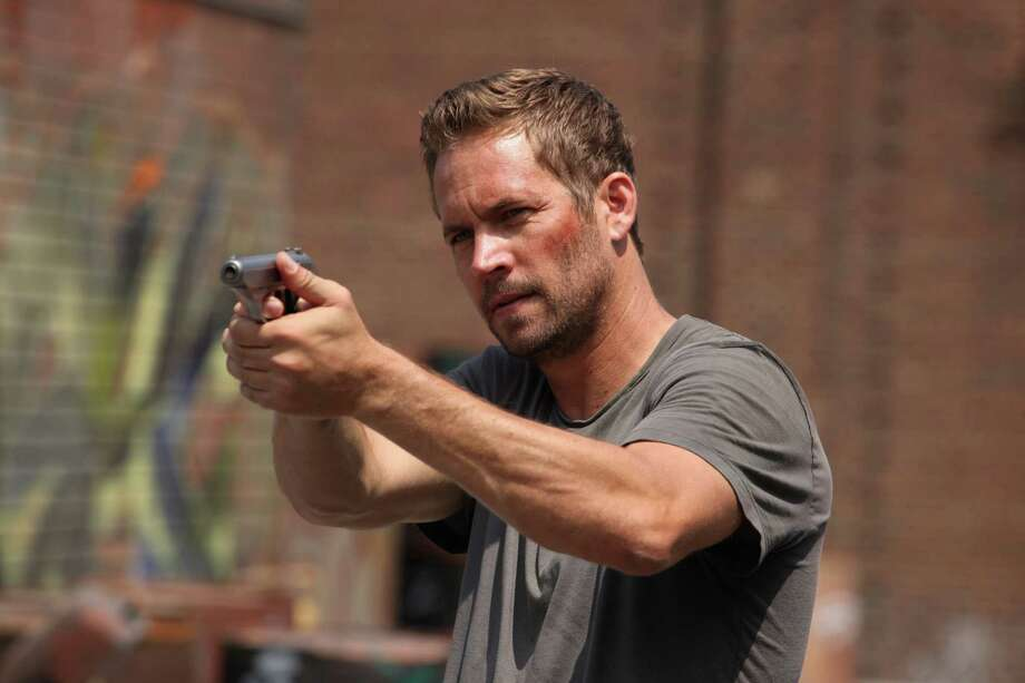 The action movie starring the late Paul Walker opens Friday. The film is about old brick mansions left to dangerous people in Detroit. Watch as the lives of an undercover officer and a man fighting to stay alive cross paths, and what that means for each of them. Photo: Philippe Bosse, Associated Press / Relativity Media