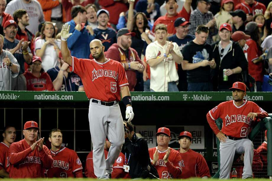 Angels manager Mike Scioscia, left, and the Washington crowd salute Albert Pujols for his achievement Tuesday night. Photo: Patrick Smith, Stringer / 2014 Getty Images