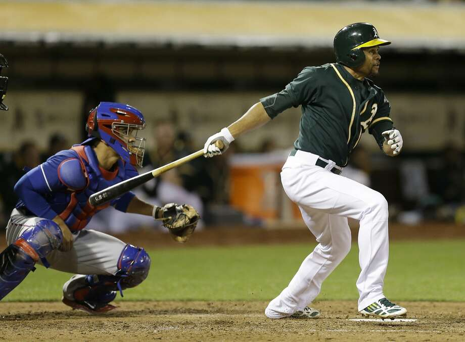 Coco Crisp doubles in the go-ahead run in the fourth inning off Texas starter Nick Martinez, but it didn't hold up. Photo: Ben Margot, Associated Press