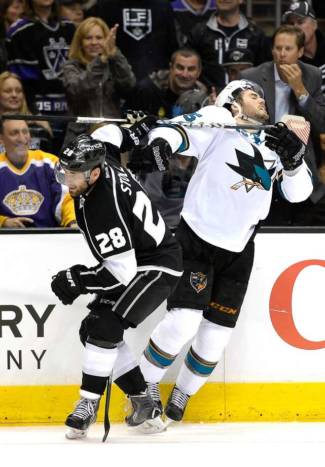 The Kings' Jarret Stoll and the Sharks' James Sheppard collide in Game 3. Photo: Harry How, Getty Images