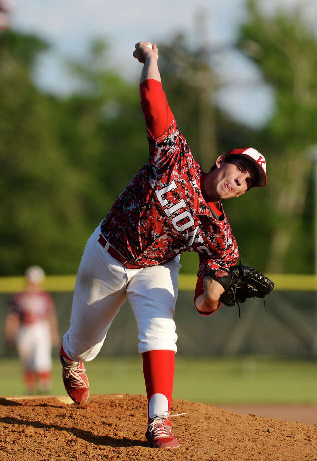 Kountze's Ethan Franklin, No. 12, throws against an East Chambers hitter during Tuesday's game. Kountze played against East Chambers at Kountze on Tuesday afternoon. Photo taken Tuesday, 4/22/14 Jake Daniels/@JakeD_in_SETX Photo: Jake Daniels / ©2014 The Beaumont Enterprise/Jake Daniels