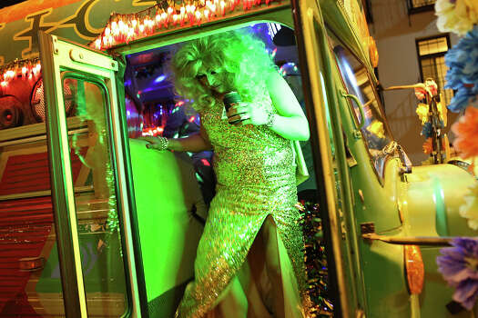 "Omar Leos, who plays RuPaul nun in ""Good Singing, Bad Acting & Screaming Goats,"" gets off the Dos Equis party bus during intermission for Cornyation at the Charline McCombs Empire Theatre in San Antonio on Tuesday, April 22, 2014. Photo: Lisa Krantz, SAN ANTONIO EXPRESS-NEWS / SAN ANTONIO EXPRESS-NEWS"