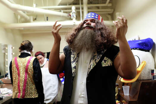 "Joey Palacios, dressed as Willie Robertson from Duck Dynasty, gets ready to perform in ""What The Duck?"" during Cornyation at the Charline McCombs Empire Theatre in San Antonio on Tuesday, April 22, 2014. Photo: Lisa Krantz, SAN ANTONIO EXPRESS-NEWS / SAN ANTONIO EXPRESS-NEWS"