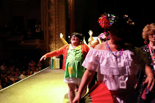 "Mark Steckly, the designer of the skit,"" Tanto Pedo,"" takes in the applause during the finale at Cornyation at the Charline McCombs Empire Theatre in San Antonio on Tuesday, April 22, 2014. Photo: Lisa Krantz, SAN ANTONIO EXPRESS-NEWS / SAN ANTONIO EXPRESS-NEWS"