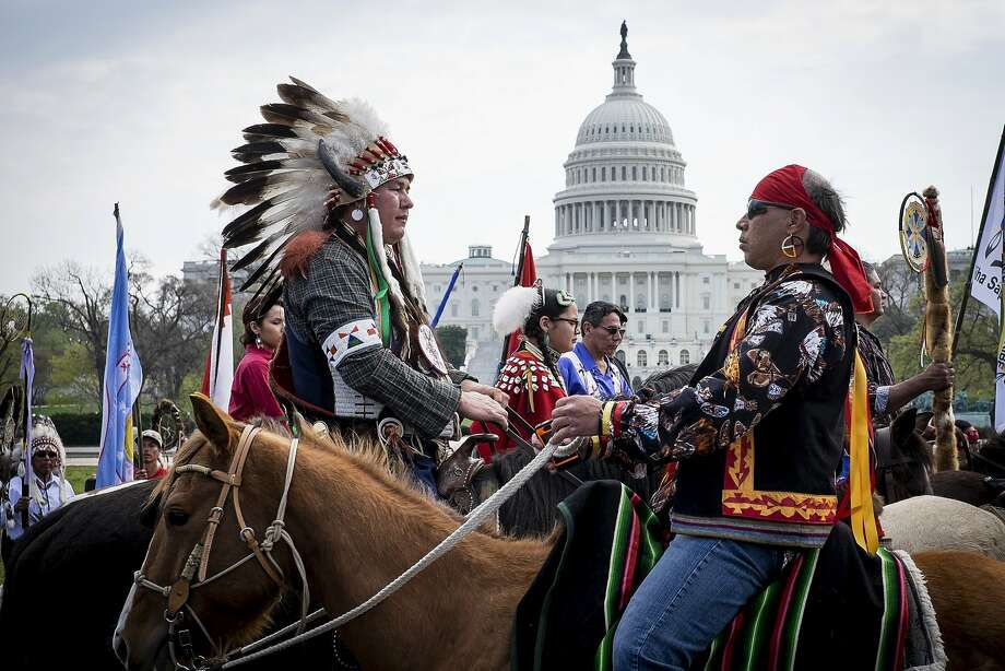 Members of the Cowboy and Indian Alliance (CIA), a group of ranchers, farmers and indigenous leaders, ride horses past the U.S. Capitol during a protest against the Keystone XL pipeline on the National Mall in Washington, D.C., U.S., on Tuesday, April 22, 2014. TransCanada Corp. is awaiting a U.S. permit to build the northern leg of Keystone XL, which would supply U.S. Gulf Coast refineries with crude from Alberta's oil sands. Because it crosses an international boundary, the proposal requires State Department approval. Photographer: Pete Marovich/Bloomberg Photo: Pete Marovich, Bloomberg
