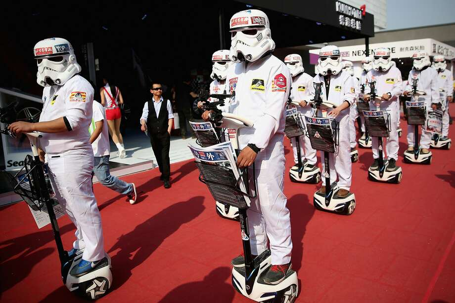 BEIJING, CHINA - APRIL 22:  People dressed up as Imperial soldiers of Star Wars film distribute promotional manual to visitors during the 2014 Beijing International Automotive Exhibition at China International Exhibition Center on April 22, 2014 in Beijing, China. More than 2,000 automotive enterprises from 14 countries and regions participated in the 2014 Beijing International Automotive Exhibition from April 20 to April 29.  (Photo by Feng Li/Getty Images) *** BESTPIX *** Photo: Feng Li, Getty Images