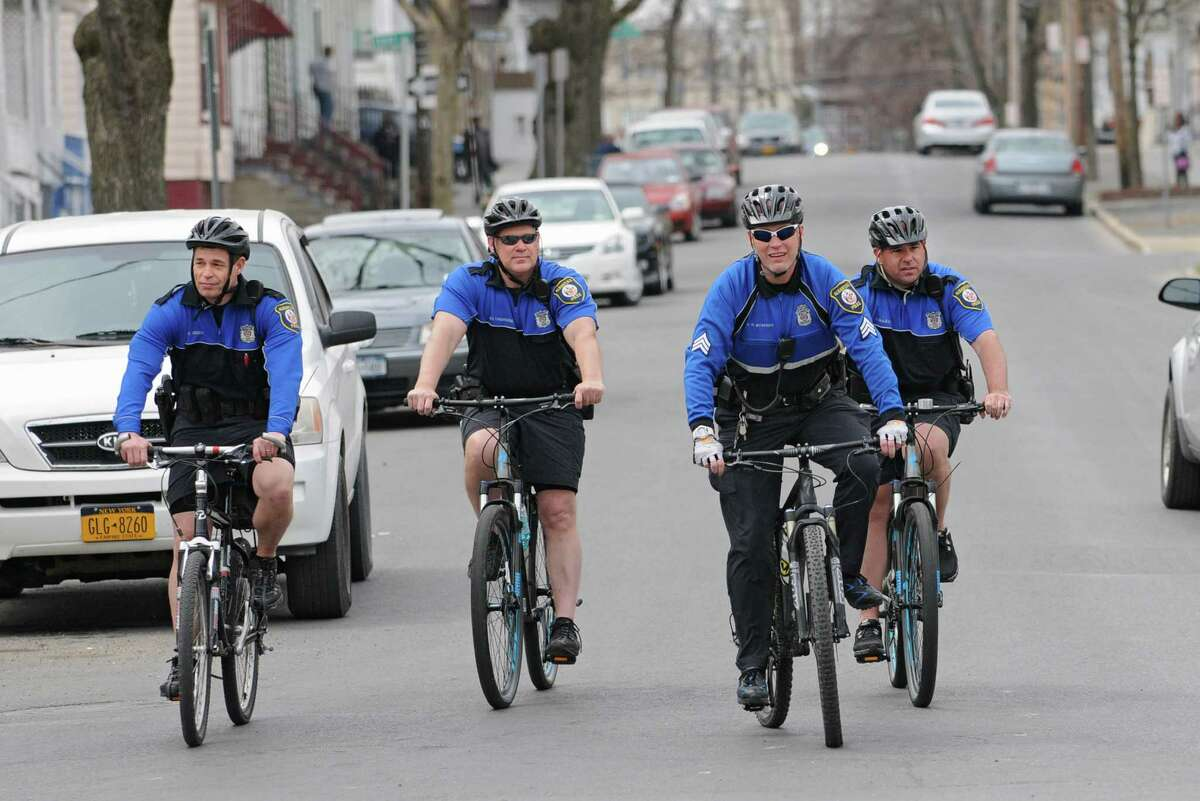 Bike mounted Albany policemen show up to Tivoli Park to participate in a bike parade to celebrate Earth Day on Tuesday, April 22, 2014 in Albany, N.Y. (Lori Van Buren / Times Union)
