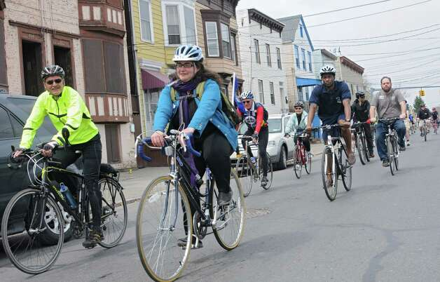 People head down Livingston Ave. as they participate in a bike parade to celebrate Earth Day on Tuesday, April 22, 2014 in Albany, N.Y. (Lori Van Buren / Times Union)
