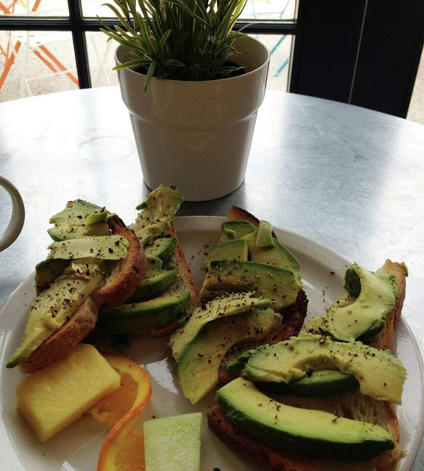 """Gourmet"" toast -- it's not just bread and butter -- is the lastest dining trend. Java Coffee and Cafe in Westport offers avocado toast ... for $8. Photo: Patti Woods / Westport News"