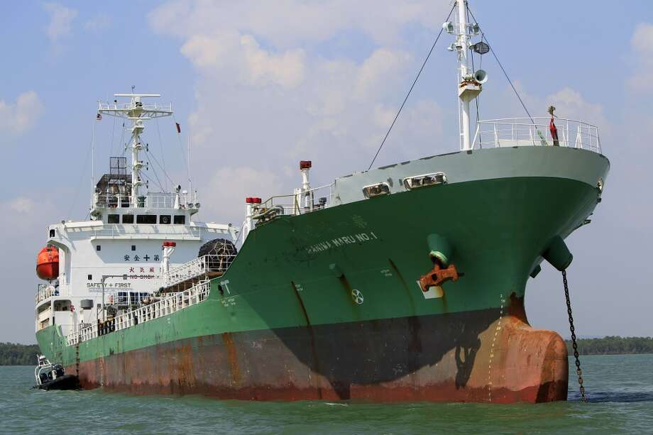 Singapore-owned tanker Naniwa Maru 1 is anchored at Klang port, Malaysia, Wednesday, April 23, 2014 after being robbed by pirates. Pirates stopped the tanker in the Malacca Strait and stole several million liters of diesel fuel it was carrying, Malaysian marine police said Wednesday. Photo: Lai Seng Sin, AP