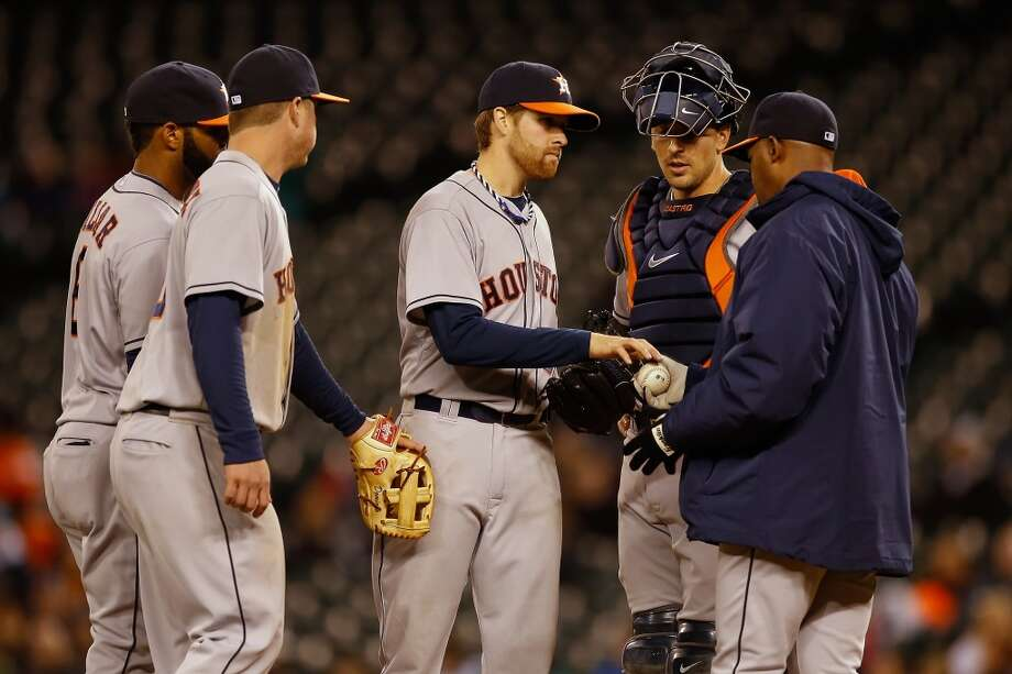 Starting pitcher Collin McHugh #31 of the Astros is removed from the game by manager Bo Porter. Photo: Otto Greule Jr, Getty Images