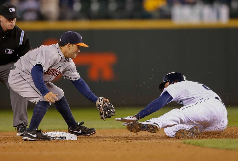 Corey Hart #27 of the Seattle is tagged out by second baseman Jose Altuve #27 of the Astros after singling to left field. Photo: Otto Greule Jr, Getty Images