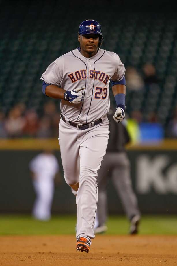 Chris Carter #23 of the Astros rounds the bases after hitting a home run. Photo: Otto Greule Jr, Getty Images