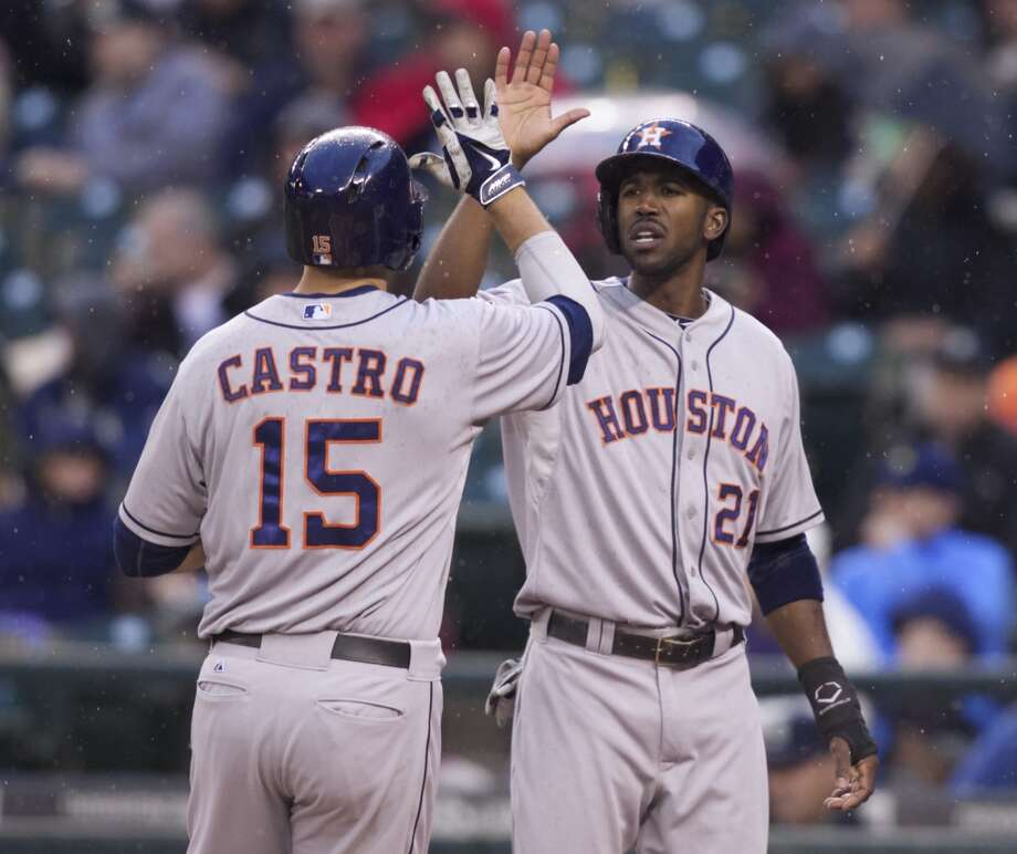 Jason Castro (15) is congratulated by teammate Dexter Fowler (21) after Castro hit a home run. Photo: STEPHEN BRASHEAR, Associated Press