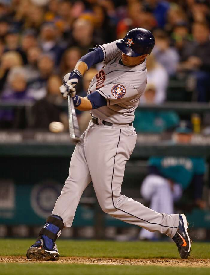 Jason Castro #15 of the Astros hits a sacrifice fly. Photo: Otto Greule Jr, Getty Images