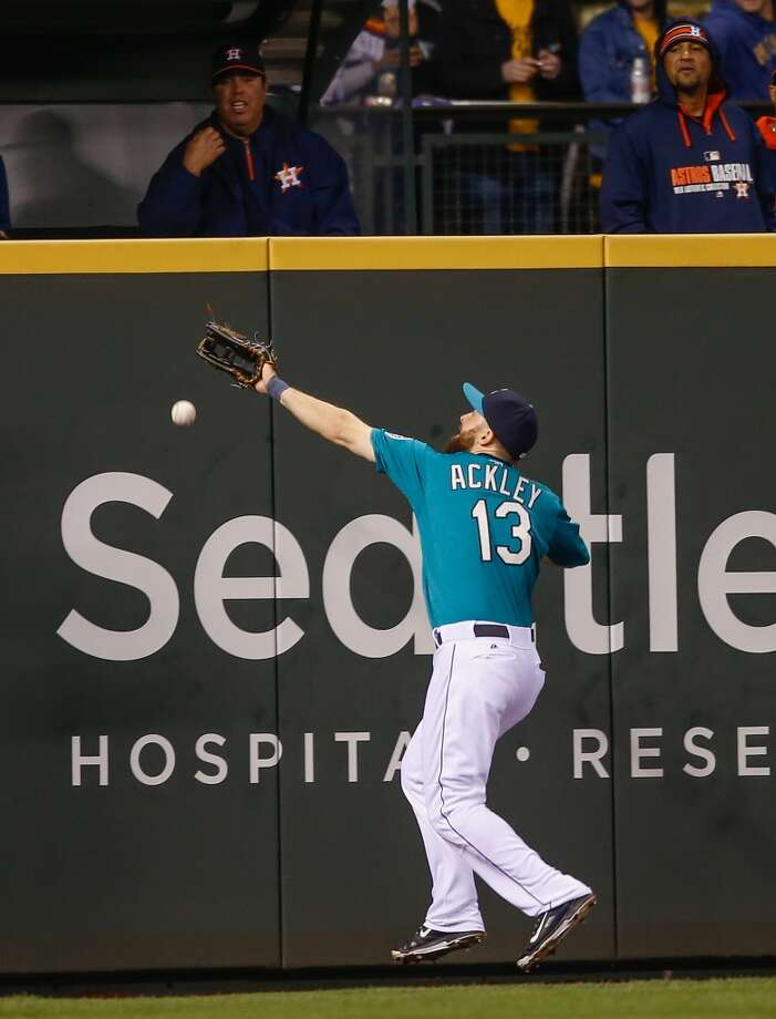 Left fielder Dustin Ackley #13 of the Mariners reaches for Matt Dominguez's RBI double. Photo: Otto Greule Jr, Getty Images