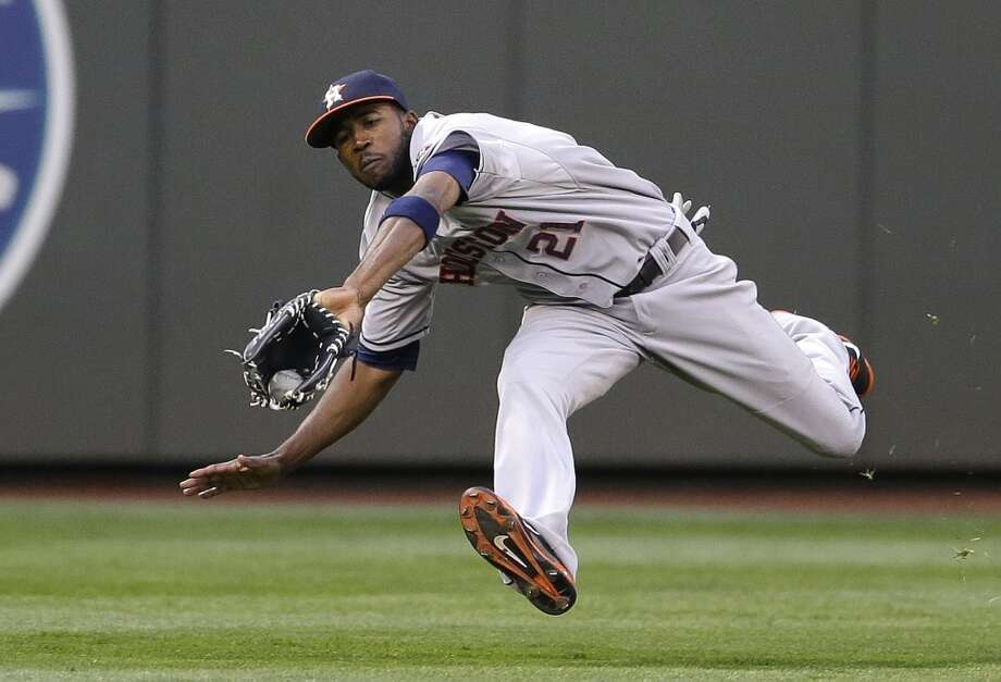 Astros center fielder Dexter Fowler makes a leaping catch. Photo: Ted S. Warren, Associated Press