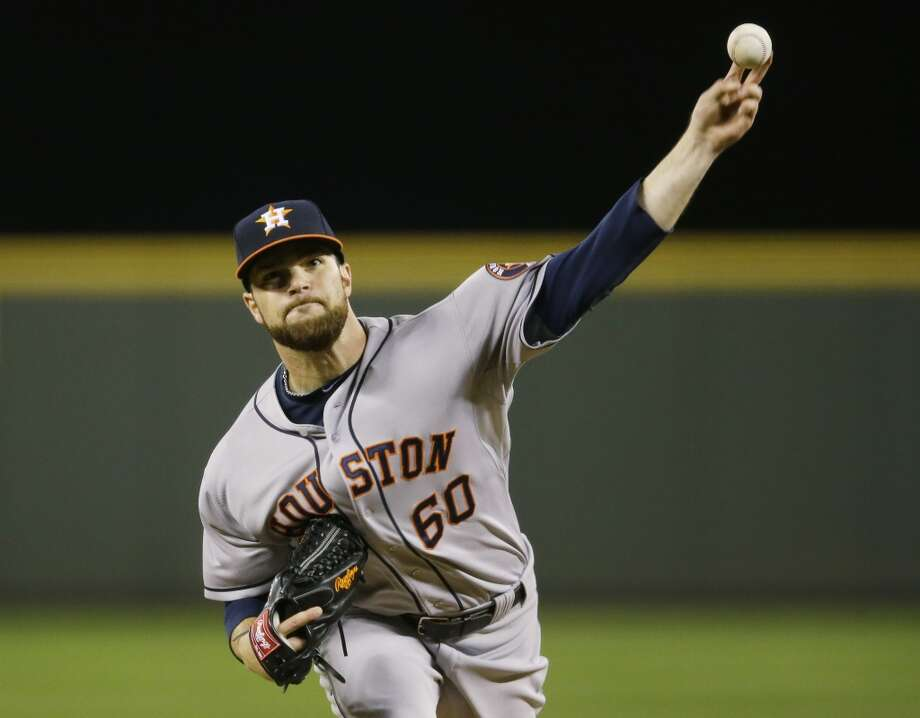Astros starting pitcher Dallas Keuchel throws during the fourth inning. Photo: Ted S. Warren, Associated Press