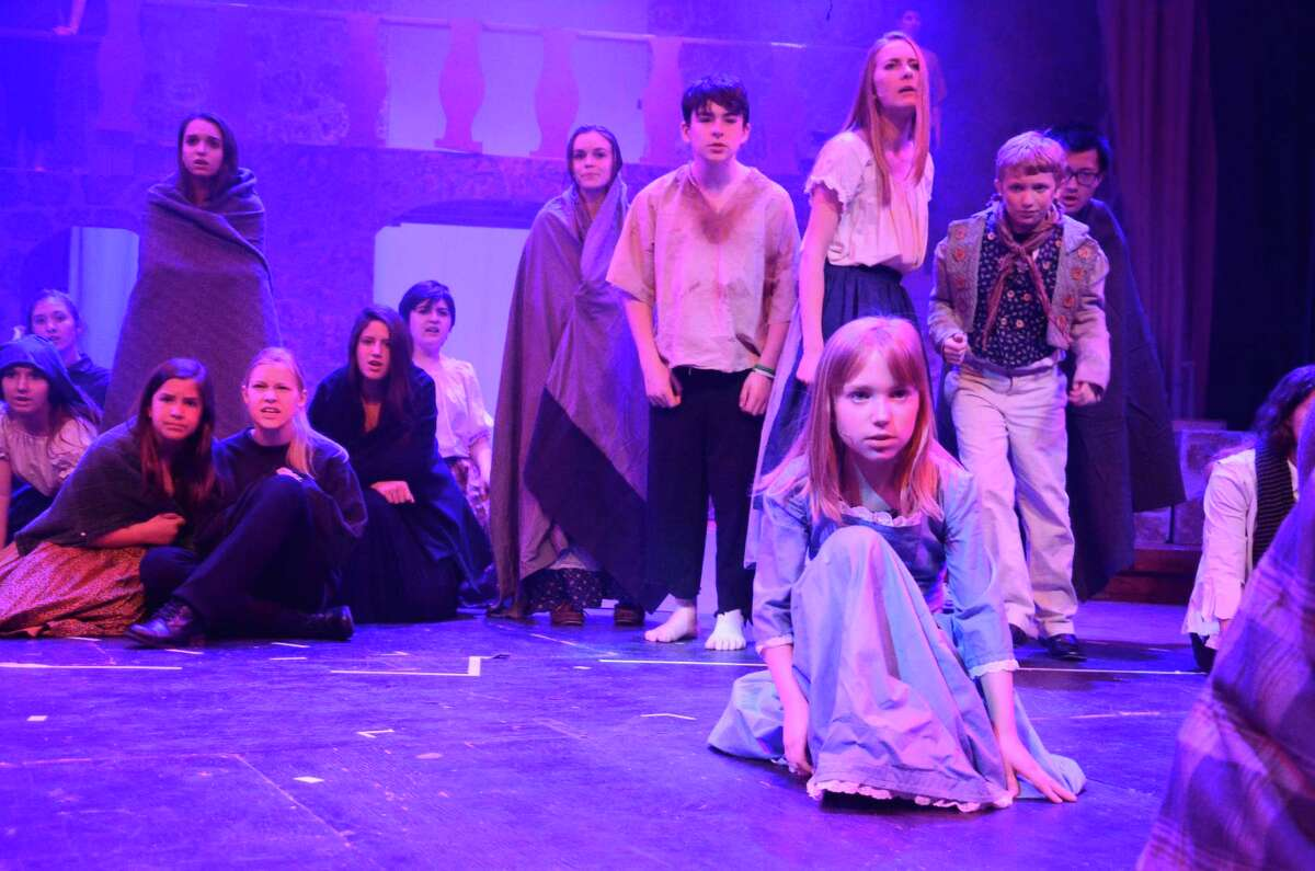 Immaculate High School students rehearse on Tuesday, April 22, 2014 for their presentation of 'Les Miserables' this weekend April 24 and April 25 at 7;00 and April 26 at 1:30 and 7:00. Go to www.immaculatehs.org to purchase tickets.