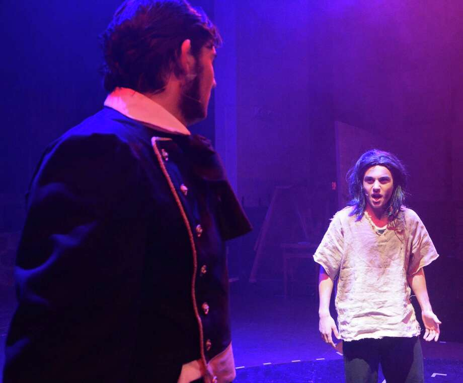 Michael Hudak, right,  plays the part of Jean Valjean and Jack Guidera is Javert in the Immaculate High School production of 'Les Miserables.' Students rehearsed on Tuesday, April 22, 2014 for their presentation of the musical this weekend April 24 and April 25 at 7;00 and April 26 at 1:30 and 7:00. Go to www.immaculatehs.org to purchase tickets. Photo: Lisa Weir / The News-Times Freelance