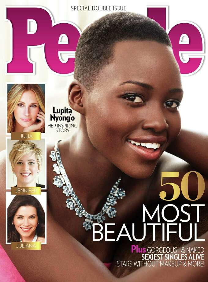 "This image provided by People magazine shows the cover of its special ""World's Most Beautiful"" issue, featuring Lupita Nyong'o.  The 31-year-old actress, who won a best supporting actress Oscar for her role in ""12 Years a Slave,"" tops the magazine's list, announced Wednesday, April 23, 2014. Photo: Uncredited, AP / People"