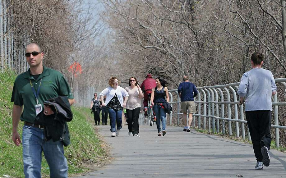 Many people used the Corning Preserve trail during lunch time on Earth Day Tuesday, April 22, 2014 in Albany, N.Y. (Lori Van Buren / Times Union) Photo: Lori Van Buren, Albany Times Union