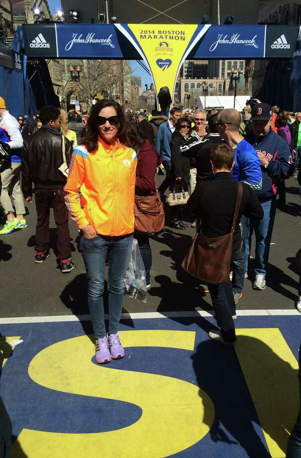 "New Canaan resident Melissa Cutler at the finish line of the Boston Marathon on Monday, April 21, 2014. Cutler, whi's run many marathons, said she had never seen such a ""supportive crowd."" Photo: Contributed Photo / New Canaan News"