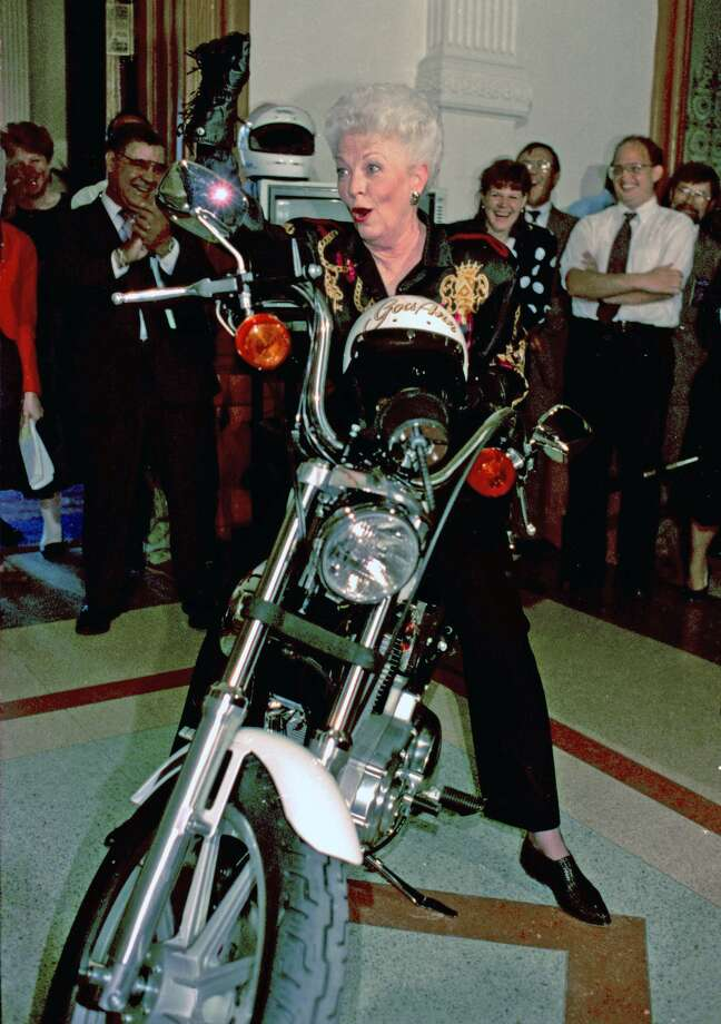 """Gov. Ann Richards  """"whoops it up"""" as she sits on a Harley Davidson motorcycle outside her  office in the State Capitol in a May 15,  1992 photo. (AP Photo/ David Breslauer,  file)"""