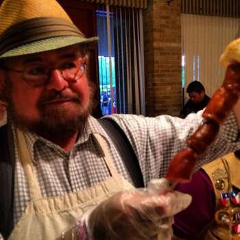 Ruben Montez displays the sausage sampler Photo: Benjamin Olivo, MySA.com