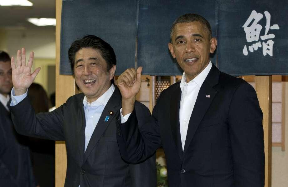 President Barack Obama and Japanese Prime Minister Shinzo Abe depart Sukiyabashi Jiro sushi restaurant in Tokyo, Wednesday, April 23, 2014. Photo: Carolyn Kaster, Associated Press