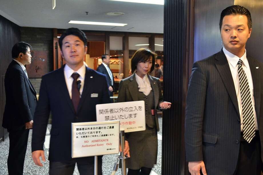 "Plainclothes policemen stand guards at the entrance of sushi restaurant ""Sukiyabashi Jiro"" in Tokyo on April 23, 2014. Photo: YOSHIKAZU TSUNO, AFP/Getty Images"