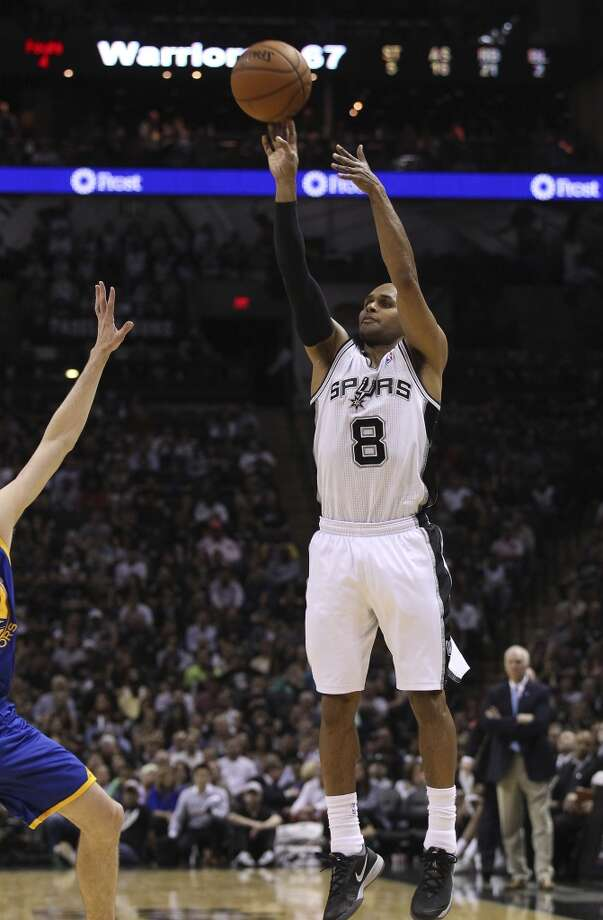Spurs' Patty Mills (08) hoists a three against the Golden State Warriors in the second half at the AT&T Center on Wednesday, Apr. 2, 2014. Spurs defeated the Warriors, 111-90. Photo: Kin Man Hui, San Antonio Express-News