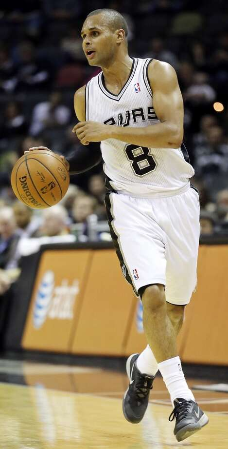 San Antonio Spurs' Patty Mills heads up court during second half action against the 76ers Monday March 24, 2014 at the AT&T Center. The Spurs won 113-91. Photo: Edward A. Ornelas, San Antonio Express-News