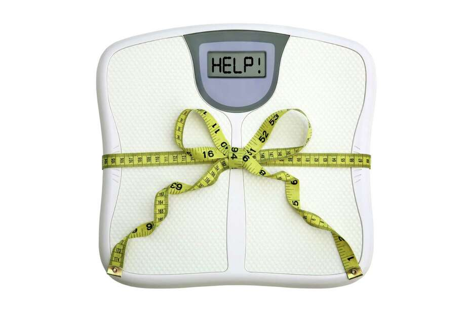 WEIGHT: To lose weight, limit calories to 1200-1500 per day. Rashid says the simplest way to keep track is consider one bite of food as 25 calories. To consume 1,200 calories, that's 50 bites; 1500 calories is 60 bites. Eat 10 bites for breakfast, 20 for lunch and 20 or 30 for dinner. (Dr. Haroon Rashid, assistant professor at Baylor College of Medicine and Kelsey-Seybold Cardiology) Photo: Amy Walters / handout / stock agency