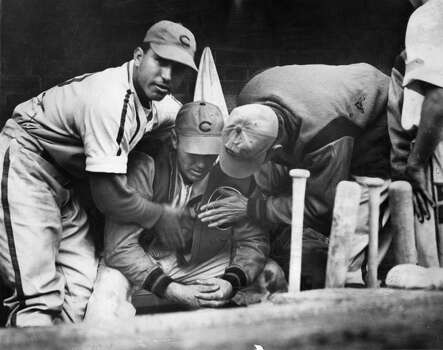 Dizzy Dean, seated at center, is inconsolable after being removed from a game on September 27, 1938  at Wrigley Field in Chicago, Illinois. (Photo Reproduction by Transcendental Graphics/Getty Images) Photo: Transcendental Graphics, Getty Images