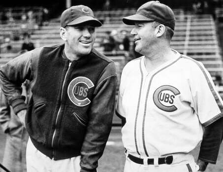 Hall of Fame baseball players Dizzy Dean, left and Gabby Hartnett share a joke before a game at Wrigley Field in Chicago, Illinois in 1938.  (Photo Reproduction by Transcendental Graphics/Getty Images) Photo: Transcendental Graphics, Getty Images