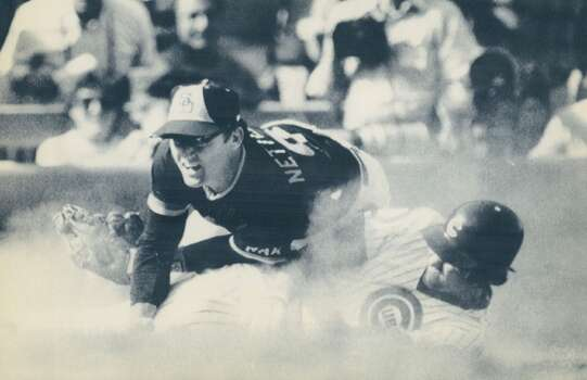 Chicago Cubs Ryne Sandberg slides safely at third as San Diego Padres' Craig Nettles misses the tag during the 1984 National League playoff opener at Chicago's Wrigley Field. Photo: Eric Bakke, Denver Post Via Getty Images