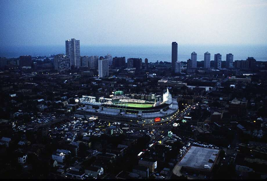 Wrigley Field finally gets lights that allow for night games.Helicopter view of the first night game in Wrigley Field between the Philadelphia Phillies and the Chicago Cubs on Aug. 8, 1988 in Chicago, Illinois.  Photo: Ronald C. Modra/Sports Imagery, Getty Images