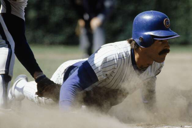Bill Buckner #22 of the Chicago Cubs slides across a base during a game in the 1980 season at Wrigley Field in Chicago, Illinois .  (Photo by: Jonathan Daniel/Getty Images) Photo: Jonathan Daniel, Getty Images