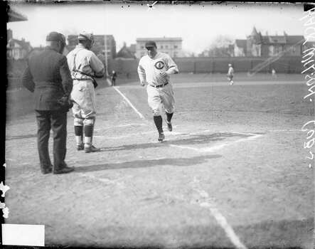 Baseball player Hack Wilson of the National League's Chicago Cubs, crossing home plate during a game at Wrigley Field in 1930. An unidentified catcher and an umpire are standing behind home plate in the foreground. (Photo by Chicago History Museum/Getty Images) Photo: Chicago History Museum, Getty Images