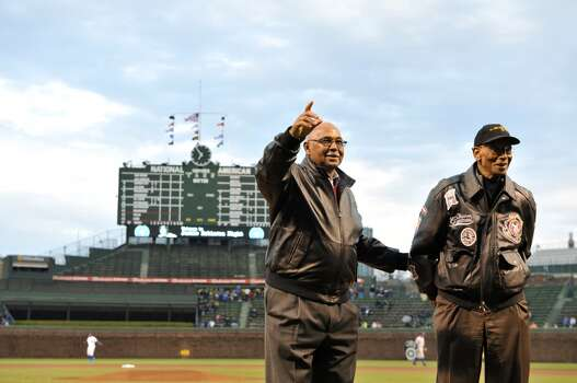 Former Chicago Cubs hall-of-famers Ernie Banks (R) and Billy Williams stand on the field as they are honored before the game against the Texas Rangers at Wrigley Field on April 16, 2013 in Chicago. (Photo by Brian D. Kersey/Getty Images) Photo: Brian D. Kersey, Getty Images