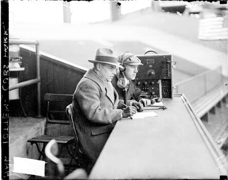 Sports announcer Hal (Harold) Totten sitting next to an unidentified man in the announcing booth at Wrigley Field, Chicago, Illinois, 1927. A microphone and a large radio unit are sitting on the counter in front of the men. Text on image reads: Cubs Park. (Photo by Chicago History Museum/Getty Images) Photo: Chicago History Museum, Getty Images