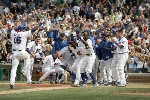 Aramis Ramirez #16 of the Chicago Cubs run to home plate where he is greeted by teammates after Ramirez hit a two-run, walk-off home run to beat the Milwaukee Brewers at Wrigley Field June 29, 2007 in Chicago, Illinois. The Cubs defeated the Brewers 6-5. (Photo by Jonathan Daniel/Getty Images) Photo: Jonathan Daniel, Getty Images